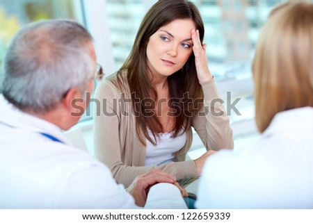 Portrait of female patient at consultation in hospital - stock photo