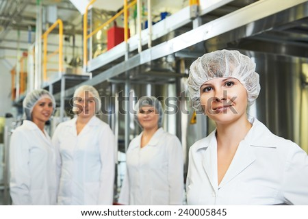 portrait of female pharmaceutical factory worker in pharmacy industry manufacture factory - stock photo