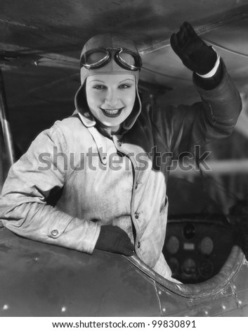 Portrait of female pilot - stock photo