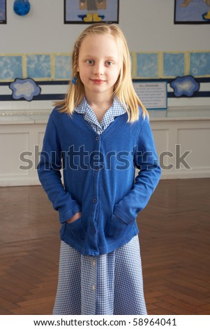 Portrait Of Female Primary School Pupil Standing In Classroom - stock photo