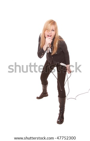 Portrait of female rock singer with microphone in hand - stock photo