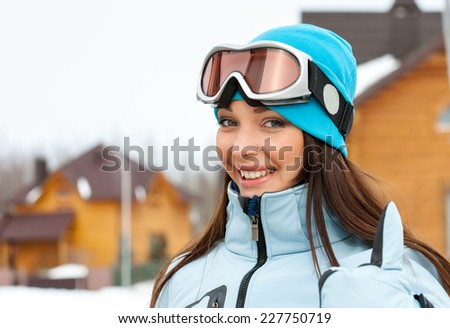 Portrait of female skier thumbing up. Concept of snow sport and healthy lifestyle - stock photo