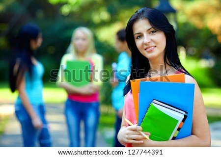 portrait of female student posing outdoors