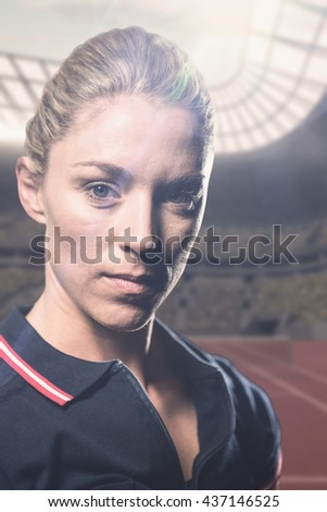 Portrait of female tennis player against tennis field on a sunny day