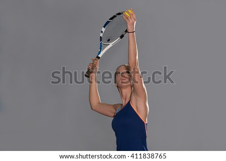 Portrait Of Female Tennis Player With Racket Ready To Hit A Tennis Ball - stock photo