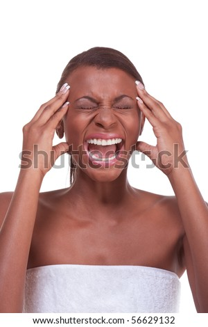 Portrait of female who is touching squeezing her head by hand and apparently suffering from severe migraine - stock photo