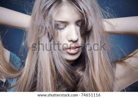 Portrait of female with long health beautiful hair