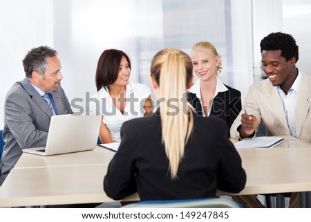 Portrait Of Female Woman Sitting At Interview