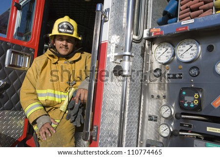 Portrait of firefighter at fire brigade's door - stock photo