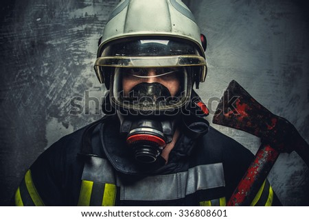 Portrait of firefighter in white helmet and oxygen mask. - stock photo