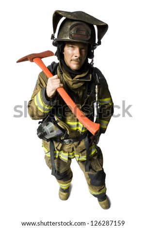 Portrait of firefighter with axe