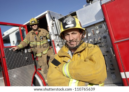 Portrait of firefighters on street - stock photo