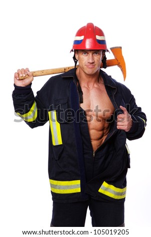 Portrait of fireman posing in studio with hummer - stock photo