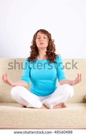 Portrait of fit young woman doing yoga exercise - stock photo