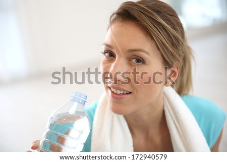 Portrait of fitness woman drinking water - stock photo