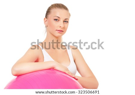 Portrait of fitness woman with fitness-ball on white background - stock photo