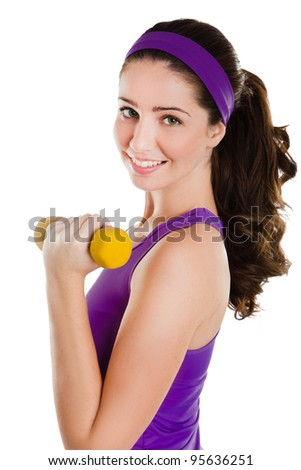 Portrait of fitness woman working out with free weights in studio - stock photo
