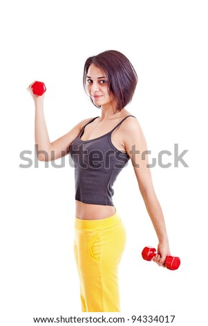 Portrait of fitness woman working out with free weights, isolated in white
