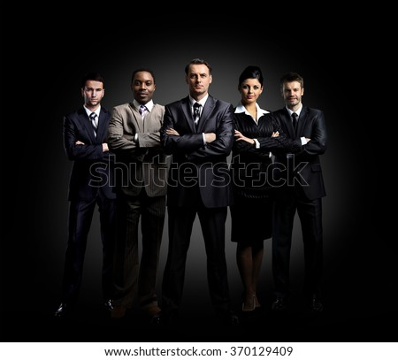 Portrait of five business people standing - stock photo