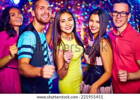 Portrait of five friends dancing at disco party - stock photo