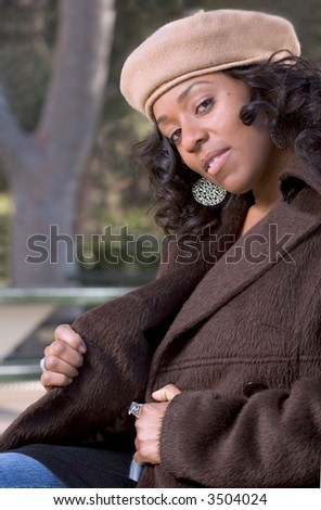 Portrait of Flirty African-American girl in the park