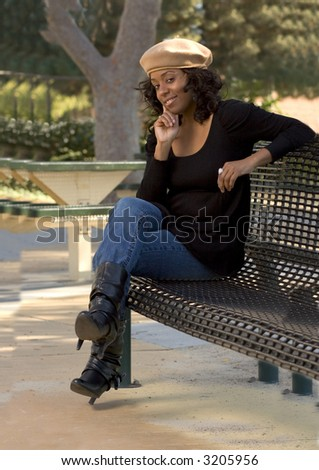 Portrait of Flirty African-American girl sitting on the bench