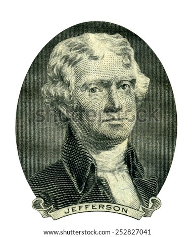 Portrait of former U.S. president Thomas Jefferson as he looks on two dollar bill obverse. Clipping path inside.  - stock photo