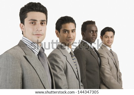Portrait of four businessmen standing together - stock photo