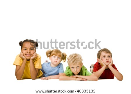 Portrait of four children lying in a line - stock photo