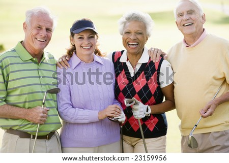 Portrait Of Four Friends Enjoying A Game Golf - stock photo