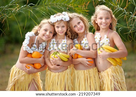 portrait of  four girls in a tropical style - stock photo