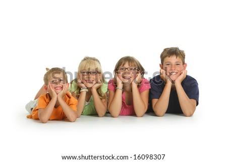 Portrait of four kids on white background - stock photo