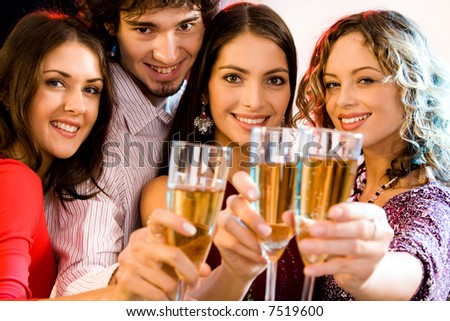Portrait of four people holding glasses of  champagne, - stock photo
