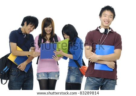 Portrait of four students with notebooks and paper folders posing - stock photo