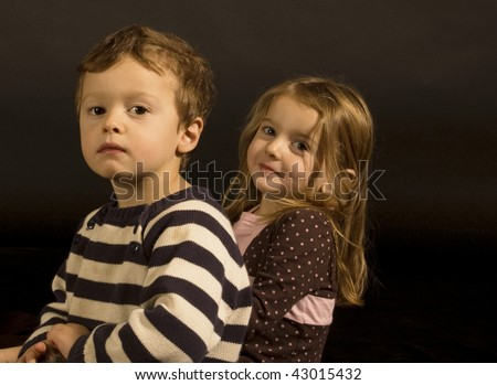 Portrait of fraternal twins in a studio setting.