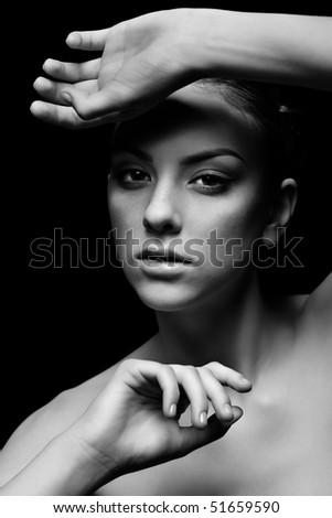 portrait of freckled dark girl posing on black - stock photo