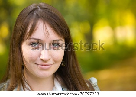 portrait of   freckled girl  outdoor in autumn - stock photo