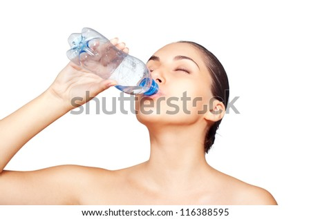 Portrait of Fresh and Beautiful brunette woman drinking water. Isolated on white background