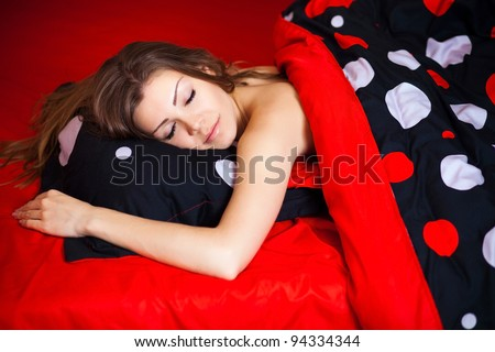 Portrait of Fresh and Beautiful brunette woman on bed