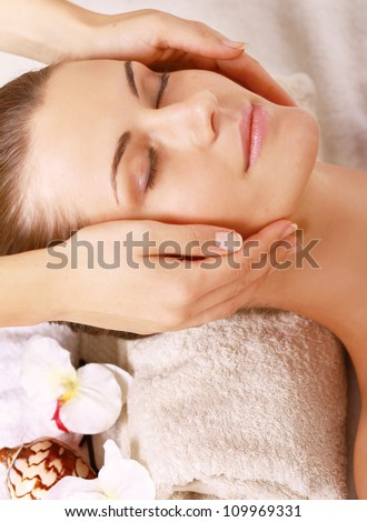 Portrait of Fresh and Beautiful brunette woman taking head massage