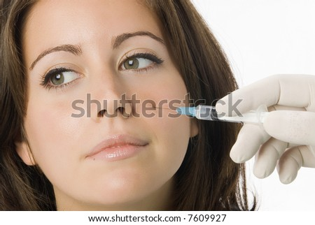 Portrait of fresh and beautiful woman getting a beauty treatment injection