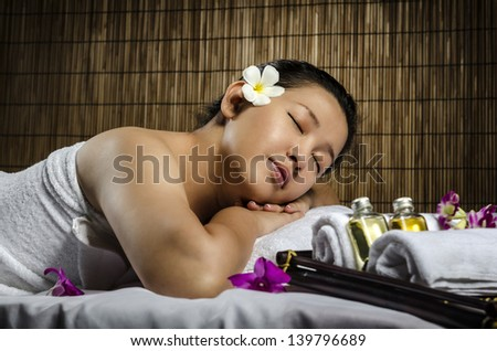 Portrait of fresh and beautiful woman laying on spa and massage - stock photo