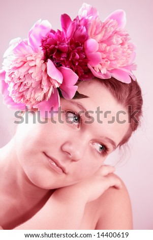 Portrait of Fresh and Beautiful woman with flower isolated on pink