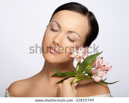 Portrait of Fresh and Beautiful woman with flowers isolated on white