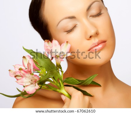 Portrait of Fresh and Beautiful woman with flowers isolated on white - stock photo