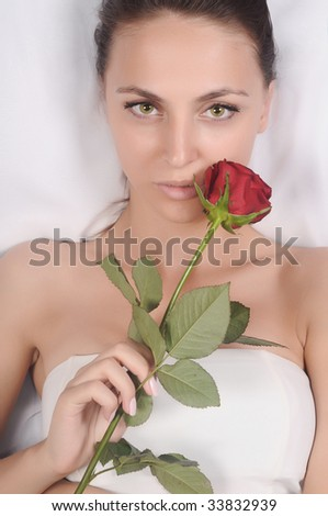 Portrait of Fresh and Beautiful woman with flowers on a white background