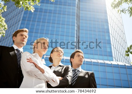 Portrait of friendly business group standing in line - stock photo