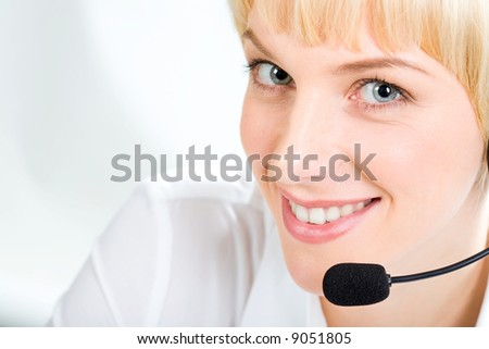 Portrait of friendly Customer Support Representative with marvelous eyes on a white background
