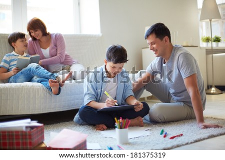 Portrait of friendly family spending leisure together at home - stock photo