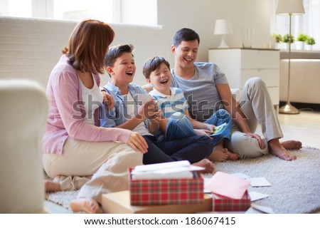 Portrait of friendly family spending time together at home - stock photo